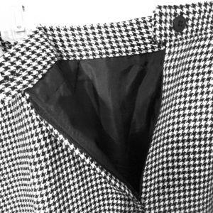 Herringbone pencil Skirt, sits below the knee.